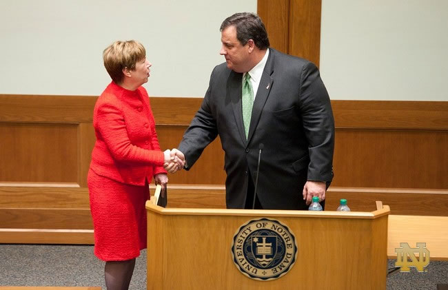 Dean Nell Jessup Newton shakes hands with New Jersey Gov